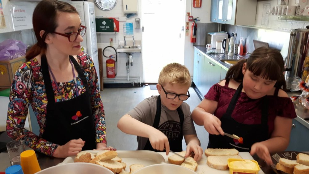 Young people learning kitchen skills at Meet Up