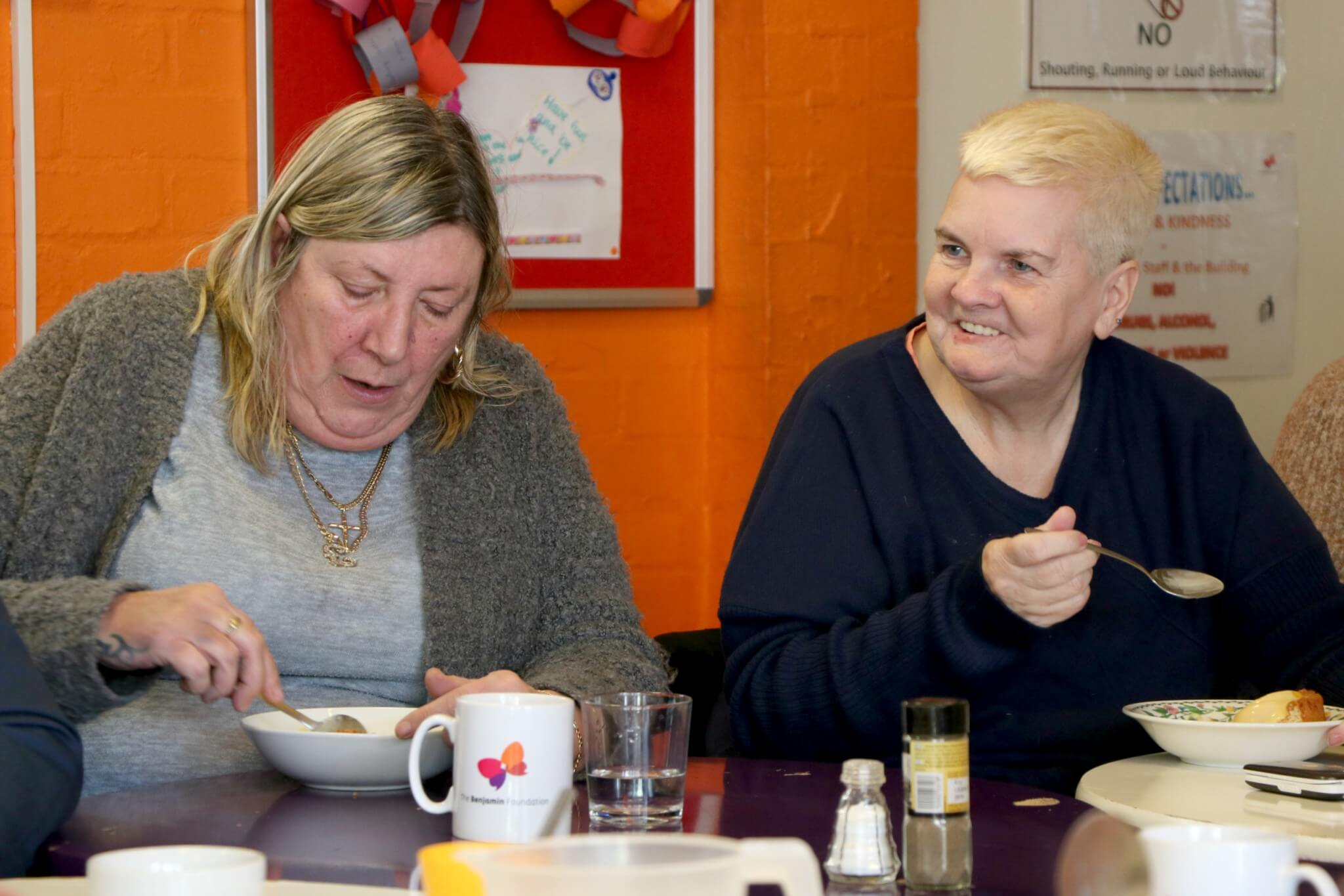 Two attendees enjoying Senior Citizen's Lunch Group at Meet Up