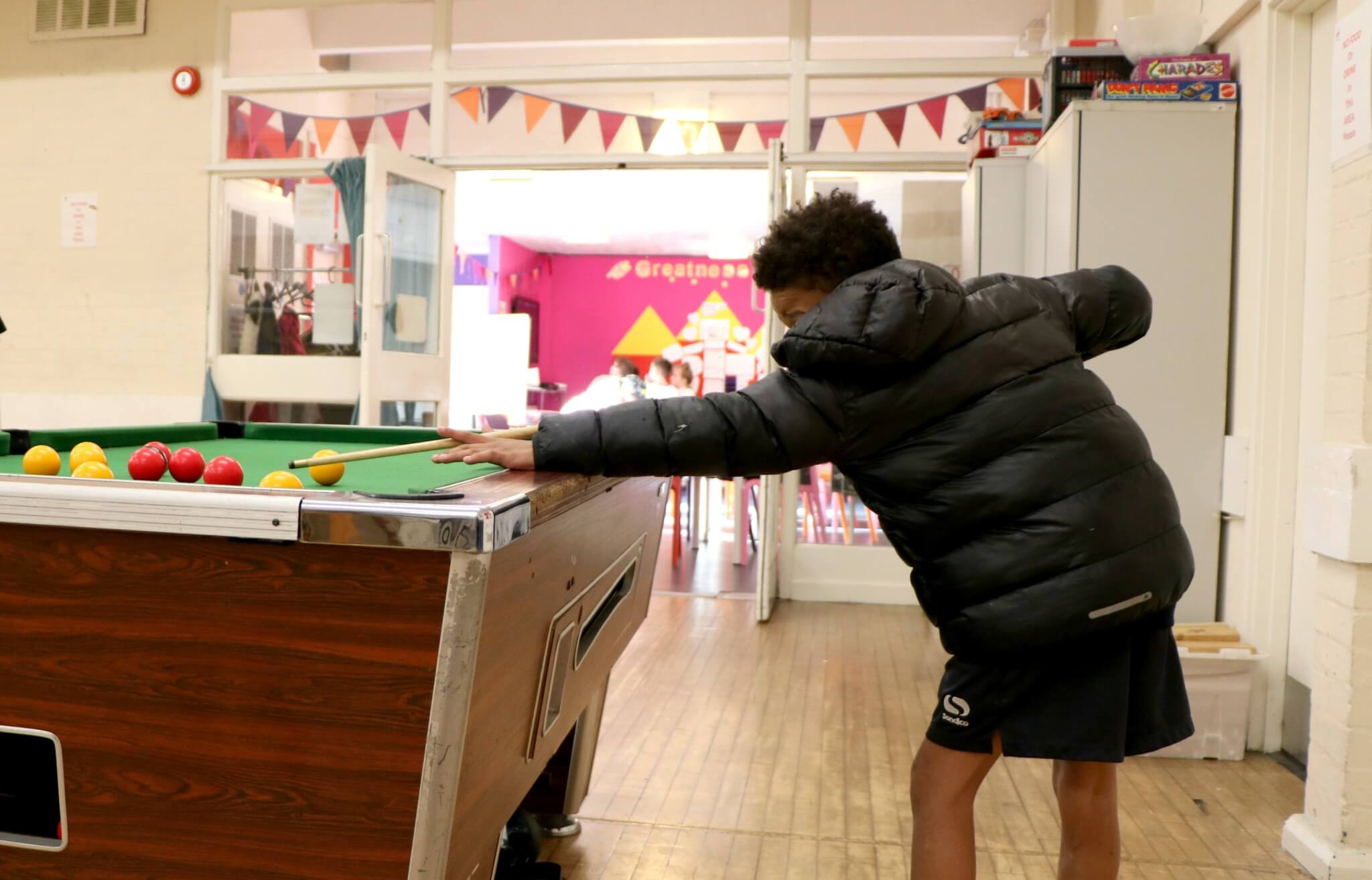 Young person at Meet Up playing pool