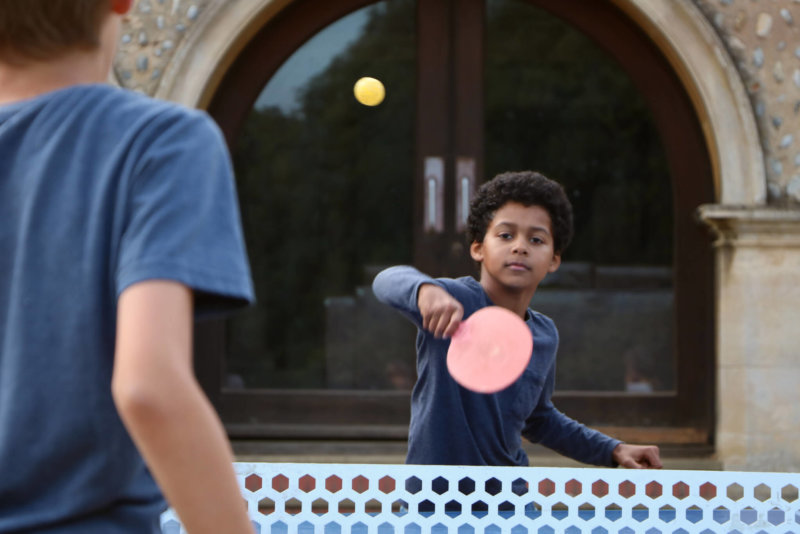 Young Carers enjoy a game of table tennis during a residential break