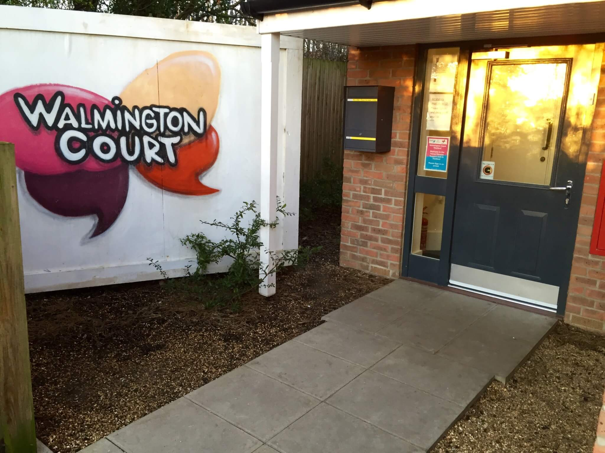 Walmington Court front door entrance with butterfly logo